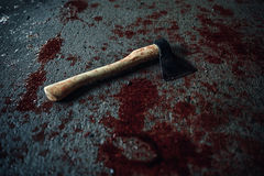 Bloody ax lying on the floor Royalty Free Stock Image