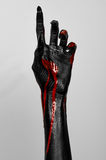 Bloody black thin hand of death. Perfomance photography session witj new characters Royalty Free Stock Images