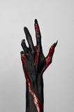 Bloody black thin hand of death. Perfomance photography session witj new characters Stock Photography