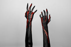 Bloody black thin hands of death. Perfomance photography session witj new characters Stock Photos