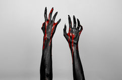 Bloody black thin hands of death. Perfomance photography session witj new characters Stock Photo