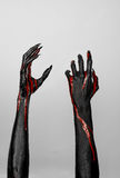 Bloody black thin hands of death. Perfomance photography session witj new characters Royalty Free Stock Images