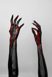 Bloody black thin hands of death. Perfomance photography session witj new characters Stock Image