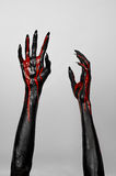 Bloody black thin hands of death. Perfomance photography session witj new characters Stock Images