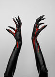 Bloody black thin hands of death. Perfomance photography session witj new characters Royalty Free Stock Photo