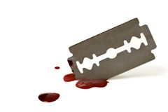 Bloody Blade. Bloody razor blade isolated over a white background royalty free stock images