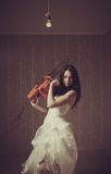 Bloody bride. Pretty seductive bride with chainsaw. Indoors shooting royalty free stock photos
