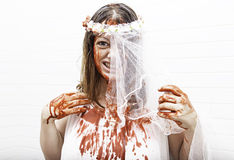 Bloody bride. Battered woman with blood, violence and horror Royalty Free Stock Photo
