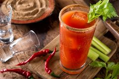 Bloody Caesar Cocktail. A delicious spicy bloody caesar cocktail with vodka, tomato juice, juice, hot sauce and celery royalty free stock images