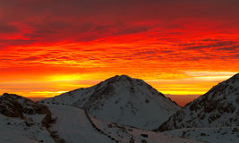 Bloody clouds in the mountains. Red sunset or sunrise stock photography