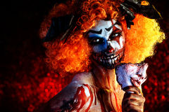Bloody clown. Close-up portrait of a terrible bloody clown with a mask. Halloween. Horror stock photo