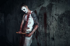Bloody clown-maniac with ax Royalty Free Stock Photo