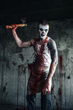 Bloody clown-maniac with ax Stock Photo