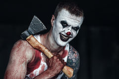 Bloody clown-maniac with ax Royalty Free Stock Photography