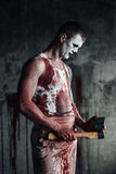 Bloody clown-maniac with ax Stock Photos