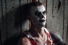 Bloody clown-maniac with ax Royalty Free Stock Photos