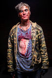 Bloody crazy zombie in dirty clothes Stock Image