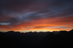 Bloody dawn. Bloody sky at sunrise with mountain line Royalty Free Stock Photography