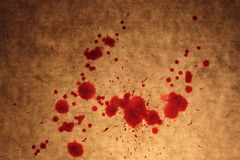 Bloody drops and stains on the old textured background Royalty Free Stock Image