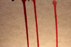 Bloody drops and stains on the old textured background Royalty Free Stock Photography