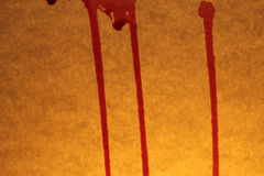 Bloody drops and stains on the old textured background Royalty Free Stock Photo