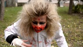 Bloody face of woman zombie stock video