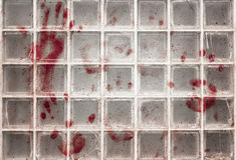 Bloody fingerprints on the glass Stock Photography