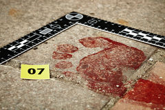 Bloody footprint on crime scene Royalty Free Stock Image