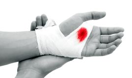 Bloody gauze. Hand of a man with bloody gauze on it Stock Photography