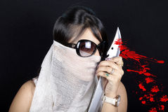 Bloody girl. Blood splashing from sword royalty free stock photos