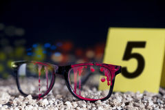 Bloody glasses at the crime scene. In the night Royalty Free Stock Photos
