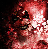 Bloody Grinning Clown. Sinister grinning clown behind a layer of bloodstained texture Stock Image