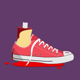Bloody Halloween parts - cutting foot wearing sneaker with blood Royalty Free Stock Photo