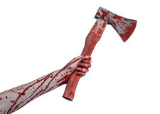 Bloody Halloween theme: bloody hand holding a bloody butcher's ax isolated on white background in studio Royalty Free Stock Photography
