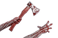 Bloody Halloween theme: bloody hand holding a bloody butcher's ax isolated on white background in studio Stock Photo