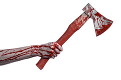 Bloody Halloween theme: bloody hand holding a bloody butcher's ax isolated on white background in studio Royalty Free Stock Image