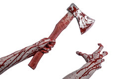 Bloody Halloween theme: bloody hand holding a bloody butcher's ax isolated on white background in studio Stock Image
