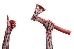 Bloody Halloween theme: bloody hand holding a bloody butcher's ax isolated on white background in studio Stock Photos