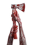 Bloody Halloween theme: bloody hand holding a bloody butcher's ax isolated on white background in studio Royalty Free Stock Photo