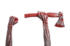 Bloody Halloween theme: bloody hand holding a bloody butcher's ax isolated on white background in studio Royalty Free Stock Photos