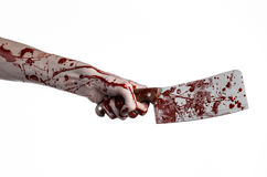 Bloody Halloween theme: bloody hand holding a large bloody kitchen knife on a white background isolated Stock Images