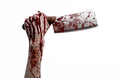 Bloody Halloween theme: bloody hand holding a large bloody kitchen knife on a white background isolated Stock Photography