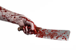 Bloody Halloween theme: bloody hand holding a large bloody kitchen knife on a white background isolated Royalty Free Stock Photo