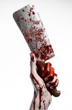 Bloody Halloween theme: bloody hand holding a large bloody kitchen knife on a white background isolated Royalty Free Stock Photography