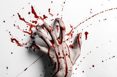 Bloody halloween theme: bloody hand print on a white leaves bloody wall Royalty Free Stock Photography