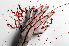 Bloody halloween theme: bloody hand print on a white leaves bloody wall Stock Image