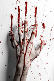 Bloody halloween theme: bloody hand print on a white leaves bloody wall Royalty Free Stock Photos