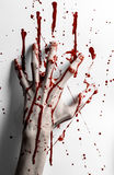 Bloody halloween theme: bloody hand print on a white leaves bloody wall Stock Photos