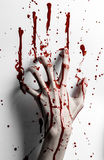 Bloody halloween theme: bloody hand print on a white leaves bloody wall Stock Images