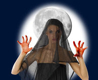 Bloody hand. Woman with black veil and bloody hand with a big moon in background Stock Photo